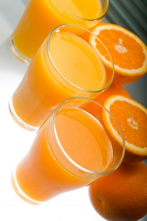 non alcoholic beverage:  healthy orange juice, unfiltered, over a light table