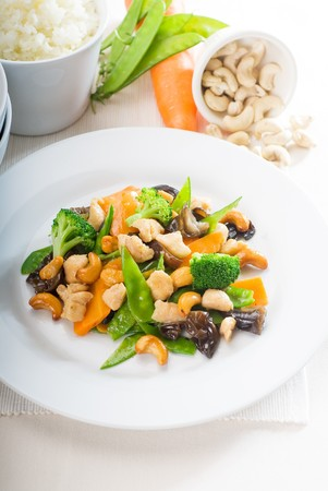 fresh chicken and vegetables stir fried with cashew nuts,typical chinese dish photo