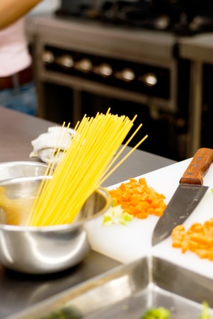 italian spaghetti pasta on a typical full equipped restaurant kitchen photo