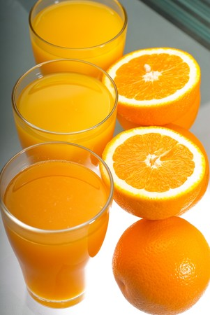 unfiltered: fresh and healthy orange juice ,unfiltered ,over a light table