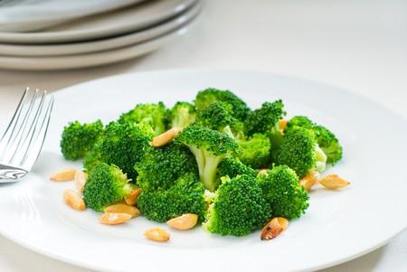 sauteed: fresh and vivid sauteed broccoli and almonds very ealthy food Stock Photo