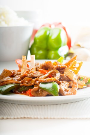 typical chinese dish,fresh beef stir fried with pepperrs bamboo sprout and mushrooms Stock Photo