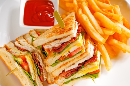 ham sandwich: fresh triple decker club sandwich with french fries on side