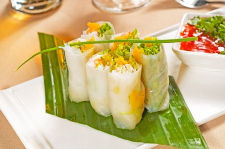 fresh tipycal vietnamese style summer rolls,on a palm leaf
