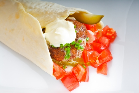 fresh traditional falafel wrap on pita bread with fresh chopped tomatoes Stock Photo - 8688703