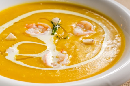 fresh pumpkin and shrimps cream soup ,with milk cream on top