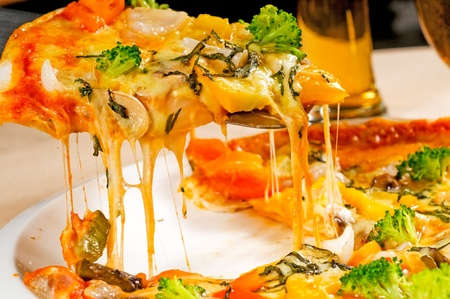 fresh italian thin style  vegetarian pizza with fresh mixed vegetables close up photo