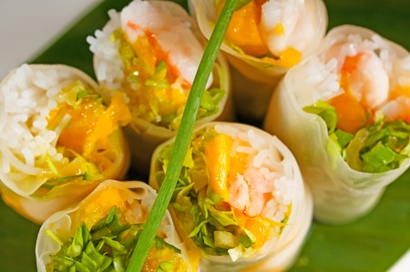 fresh tipycal vietnamese style summer rolls,on a palm leaf Stock Photo - 9028239