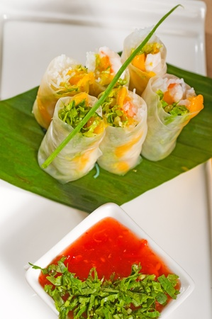 spring onion: fresh tipycal vietnamese style summer rolls,on a palm leaf