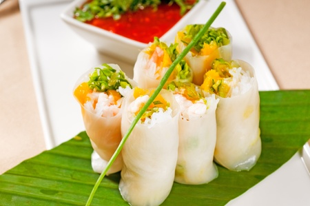 spring roll: fresh tipycal vietnamese style summer rolls,on a palm leaf