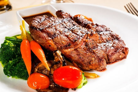 steak plate: fresh grilled ribeye steak with broccoli,carrot and cherry tomatoes on side