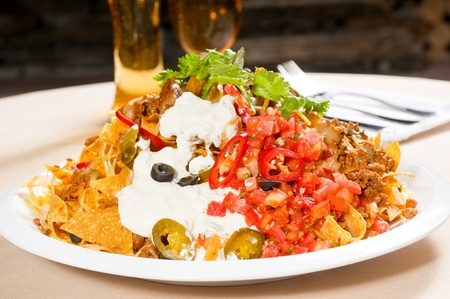 fresh nachos and vegetable salad with meat ,chili con carne  ,tipycal mexican food photo