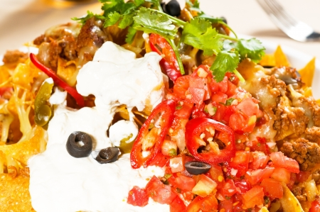 nachos and vegetable salad with meat, chili con carne, tipycal mexican food photo