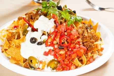 fresh nachos and vegetable salad with meat ,chili con carne  ,tipycal mexican food