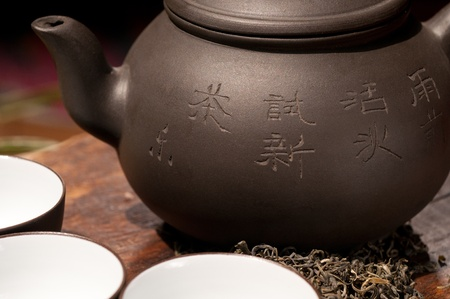 chinese teapot: chinese green tea traditional  pot and cups over old wood board  Stock Photo