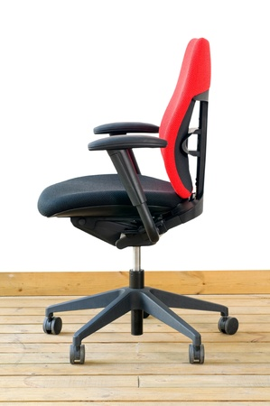 modern red office chair on wood floor over white background Stock Photo - 9742711