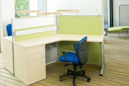 office cubicle: office desks ,and blue chairs cubicle set view from top over wood flooring