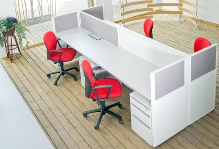 office cubicle: office desks ,and red chairs cubicle set view from top over wood flooring
