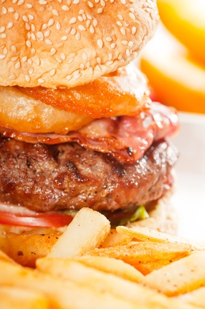 classic american hamburger sandwich with onion rings and french fries photo