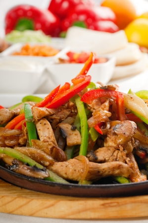 original fajita sizzling smoking hot served on iron plate and fresh vegetables on background ,MORE DELICIOUS FOOD ON PORTFOLIO Stock Photo - 10388595