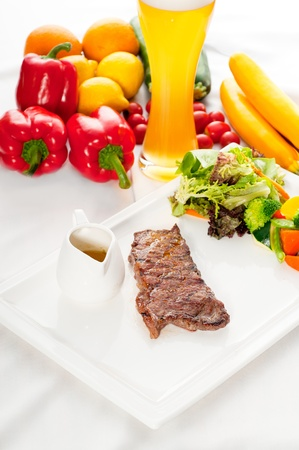 juicy BBQ grilled rib eye ,ribeye steak ,vegetables and lagher beer on background. Stock Photo - 10452655