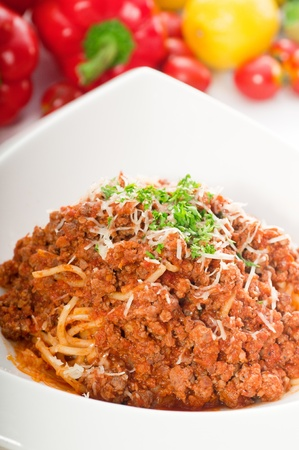 Italian classic  spaghetti with bolognese sauce and fresh vegetables on background,MORE DELICIOUS  FOOD ON PORTFOLIO