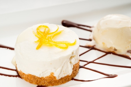very elegant lemon mousse dessert served whith lemon peel on top and vanilla ice cream on side, MORE DELICIOUS FOOD ON PORTFOLIO photo