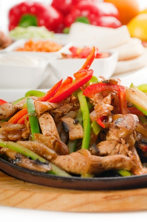 original fajita sizzling smoking hot served on iron plate and fresh vegetables on background ,MORE DELICIOUS FOOD ON PORTFOLIO photo