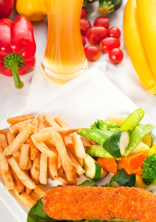 fresh breaded chicken breast roll and vegetables,with lager beer and fresh vegetables on background photo