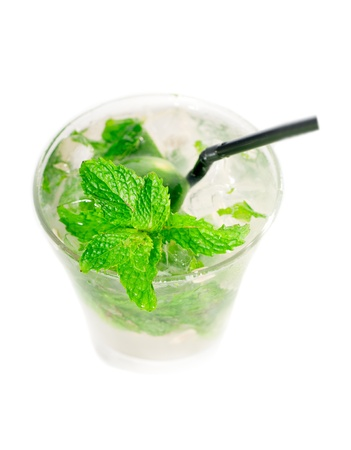 mojito caipirina cocktail with fresh mint leaves ,yerba-buena, with lime and black straw isolated on white background Foto de archivo