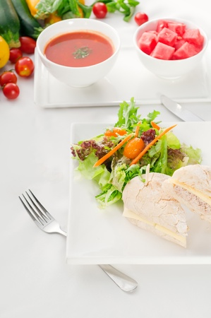 tunafish: tuna fish and cheese sandwich with fresh mixed salad ,watermelon and gazpacho soup on side,with fresh vegetables on background ,MORE DELICIOUS FOOD ON PORTFOLIO