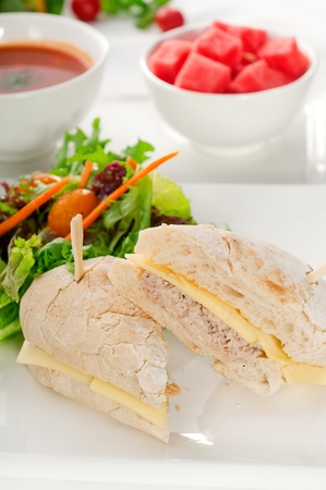 tuna fish and cheese sandwich with fresh mixed salad ,watermelon and gazpacho soup on side,with fresh vegetables on background ,MORE DELICIOUS FOOD ON PORTFOLIO photo