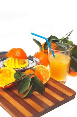 making fresh orange juice over white Stock Photo - 11935606