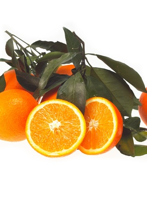 fresh orange with green leaves  isolated over white photo