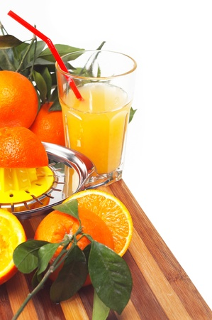 making fresh orange juice over white photo