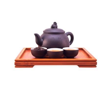 chinese green tea clay pot and cups on bamboo wood tray isolated over white photo