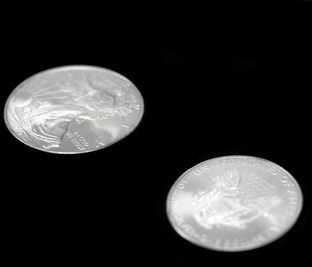 American silver eagle dollar coin over black photo