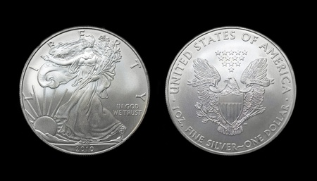 silver: American silver eagle dollar coin over black