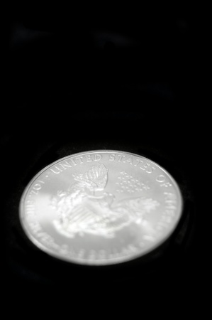 american silver eagle: American silver eagle dollar coin over black