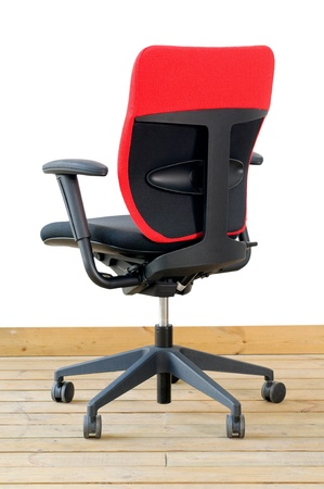 modern red office chair on wood floor over white background Stock Photo - 12183809
