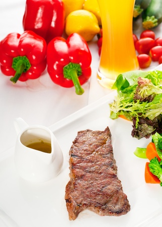 juicy BBQ grilled rib eye ,ribeye steak ,vegetables and lagher beer on background ,MORE DELICIOUS FOOD ON PORTFOLIO photo
