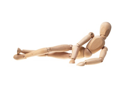 wood mannekin laying onn side over white Stock Photo - 12732975
