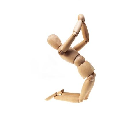 wood figurine: wood mannekin on praying position isolated over white Stock Photo