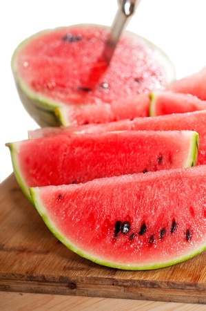 fresh ripe watermelon sliced on a  wood table with knife Stock Photo - 13918738