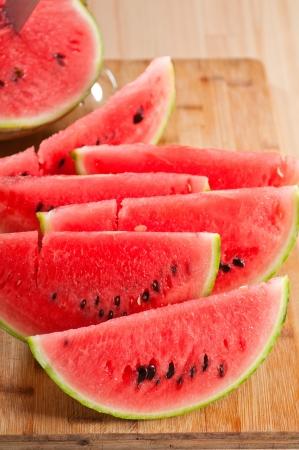 fresh ripe watermelon sliced on a  wood table