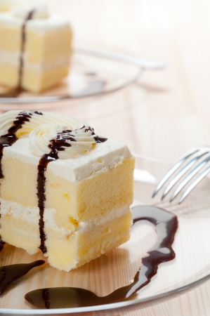 fresh cream cake closeup with chocolate sauce topping  photo