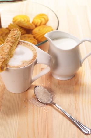 breakfast with coffee and fresh baked  pastry over a natural pine wood table Stock Photo - 14328363