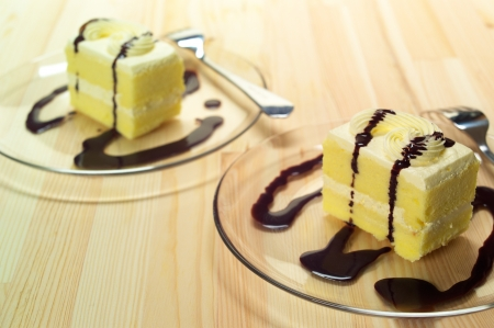 fresh cream cake closeup with chocolate sauce topping  photo