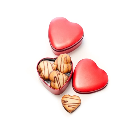 heart shaped cream cookies on red heart metal box photo