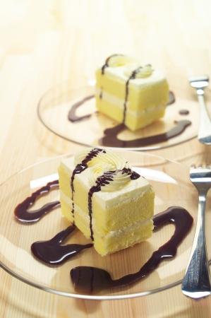 fresh cream cake closeup with chocolate sauce topping